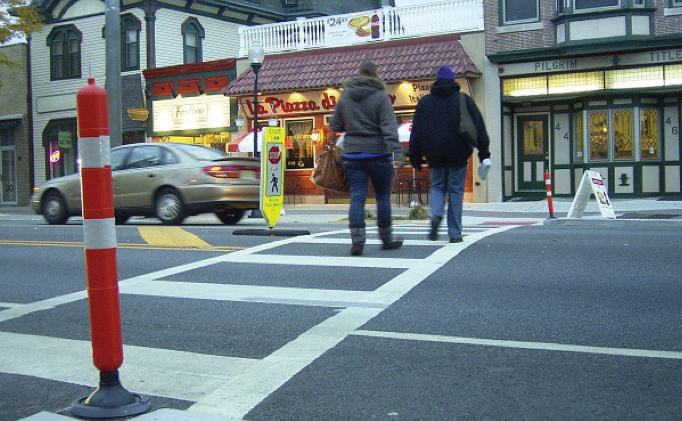 people walking across crosswalk
